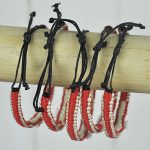 Red and natural bangle with shell cross