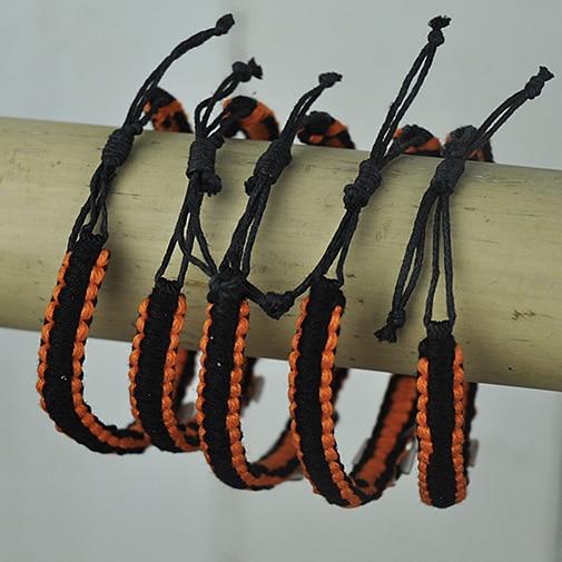 Orange and Black bangle with shell cross