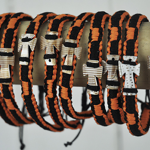Orange and Black bangle with shell cross